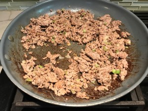 Cooked ground chicken in a pan for Dan Dan Noodle Recipe with Ground Chicken.