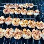 Shrimp skewers grilling on outdoor grill for Grilled Shrimp Tacos