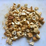 Cashews chopped on cutting board for this Cashew Chicken Lettuce Wrap Recipe