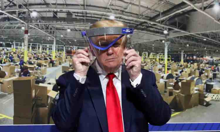President Trump holding up but not wearing face shield during a tour of Ford Rawsonville Components Plant – Talk of Naija