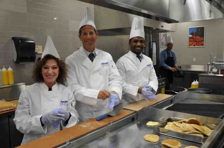 Guess Who was Flipping Pancakes at the New Monroe College Dining Facility this Morning
