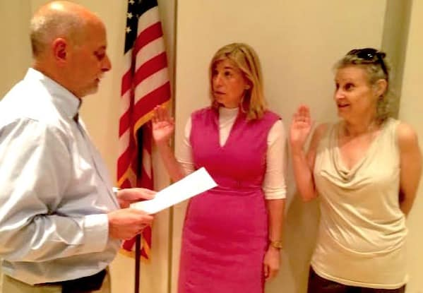 Greg Varian (left) swears in Haina Just-Michael (center) and Emery Schweig (right) in 2014 after they each won their second term.