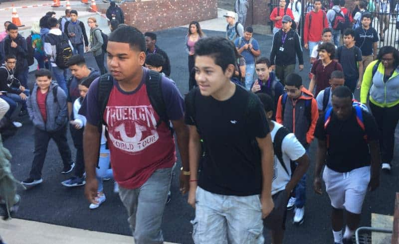 Students stream into New Rochelle High School Friday morning. It was the first day of classes for juniors and seniors