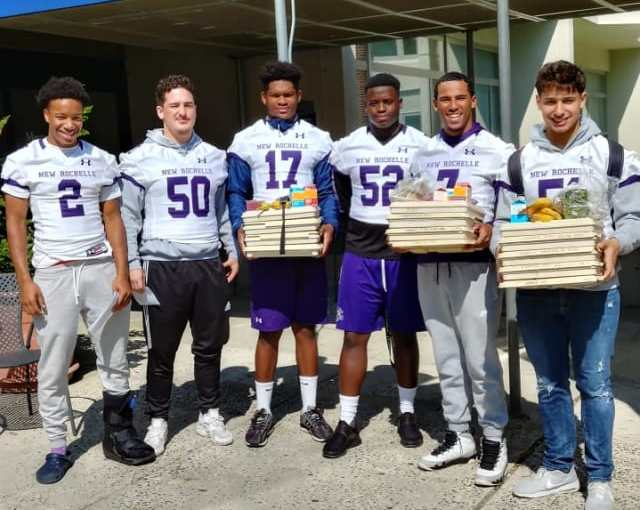 Players from the New Rochelle Varsity football team delivering meals to patients at Montefiore Hospital. Photo Credit: Contributed