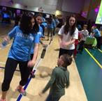 College students and former Maria Fareri Children's Hospital patients share the dance floor during the IonaTHON Dance Marathon