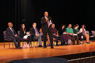 Board of Education President Jeffrey Hastie addresses the community members at the Town Hall meeting.