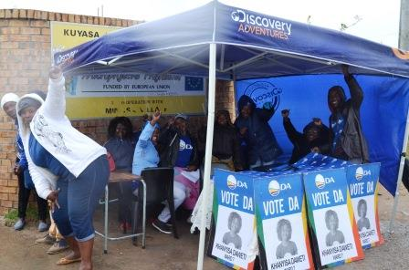 BLUE BRIGADE: Cheerful and wet in the rain are supporters and DA members at the Ward 7 voting station