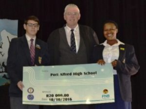 CHEQUE POINT: The Port Alfred High School Interacters handed over a cheque for R20 000 to the school on Monday October 10 to assist in the restoration of the foyer and office which was burnt down earlier in the year. Corne Odendaal, left, and Volisa Bobo, right, presented the cheque to principal Clive Pearson at the school assembly Picture: ROB KNOWLES