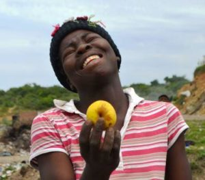 LIKE MANNA FROM HEAVEN: For Siphokazi Mxuma, a 25-year-old mother of a baby girl, finding an intact apple while scavenging for food on the Port Alfred municipal dump is something to celebrate Picture: LOUISE KNOWLES