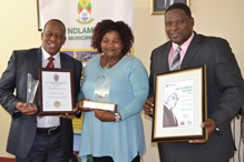 PROUD MOMENTS: Ndlambe Municipality proudly displayed their accomplishments at the open council meeting on Monday, including the Govan Mbeki award for the housing development at Kenton-on-Sea as well as the Auditor General's award for the most improved municipality with respect to the 2014/2015 audit report. Municipal manager Rolly Dumezweni, left, held the AG's award and certificate while ANC councillor Monica Mateti, centre, and mayor Phindile Faxi showed off the Govan Mbeki award and certificate Picture: ROB KNOWLES