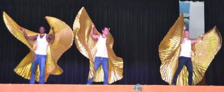 BOYS WITH WINGS: From left, Aldair Borges, Kirsten Jones and Kyle Badenhorst in one of the acts