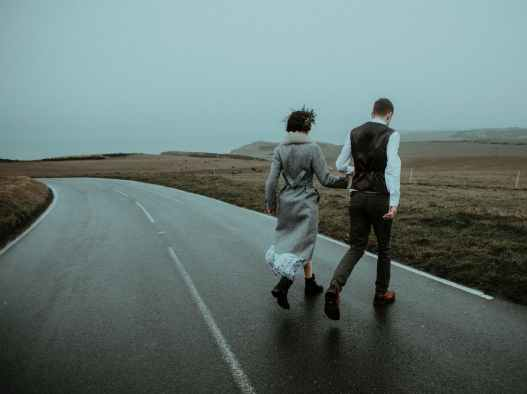 photo of couple walking on road