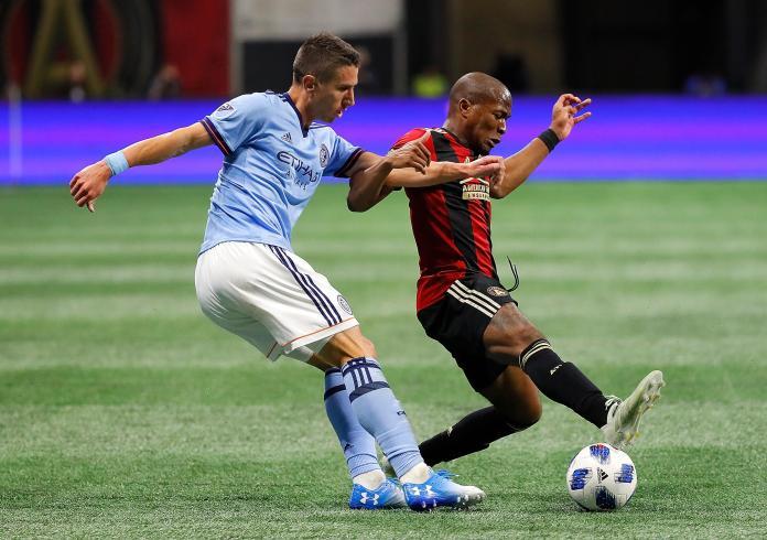 Darlington Nagbe (right) makes a crucial block