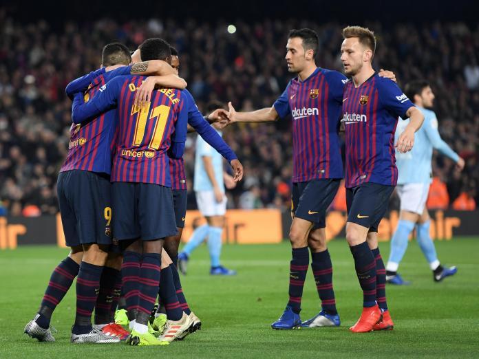 Ivan Rakitic celebrates a Barcelona goal with his team-mates.