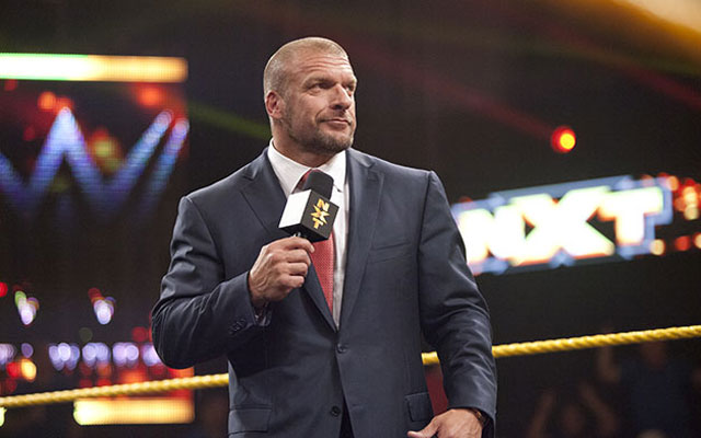 Triple H standing in an NXT ring