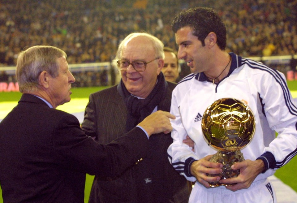 Real Madrid star Luis Figo collects his award in 2000