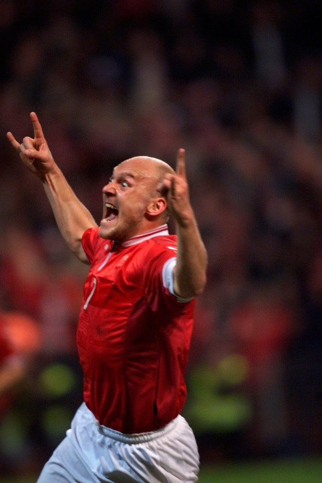 Gravesen celebrates one of his goals against Iceland in a wild way
