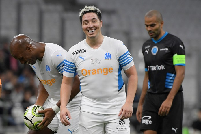 Nasri was in good spirits during the game