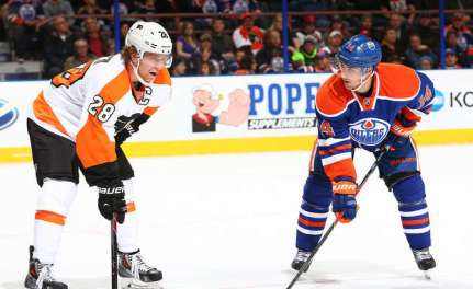 EDMONTON, AB - DECEMBER 28: Jordan Eberle #14 of the Edmonton Oilers exchanges words with Claude Giroux #28 of the Philadelphia Flyers prior to a face off on December 28, 2013 at Rexall Place in Edmonton, Alberta, Canada. (Photo by Marko Ditkun/NHLI via Getty Images)