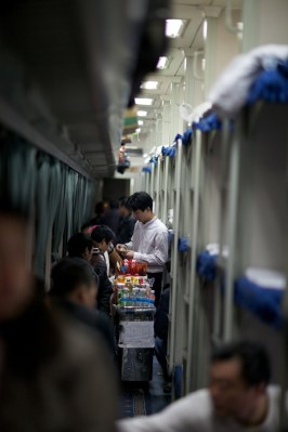 Men serving food and snack on the train.