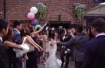 I always love confetti moments. I love the reactions from the couple and their guests! Fujifilm 800, Leica 35mm Summilux 1:1.4 Classic