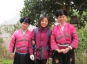 Two local women in traditional Miao costumes.