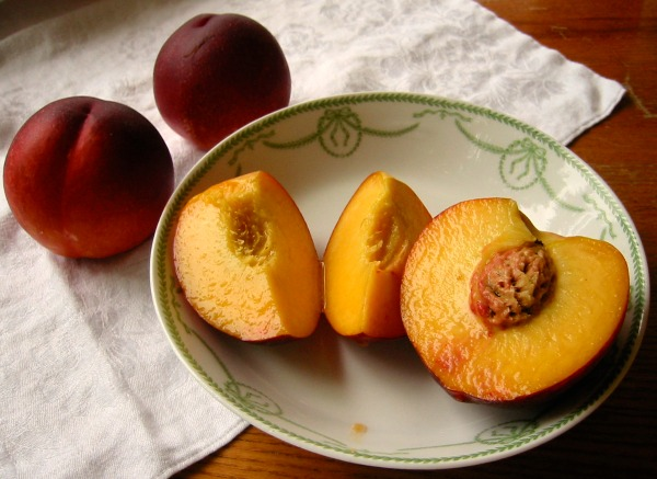 Peaches, dripping with juices, when left to ripen