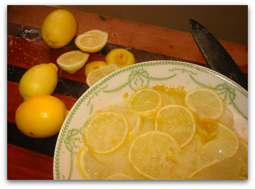 shaker lemon pie recipe begins with sliced sugared lemons