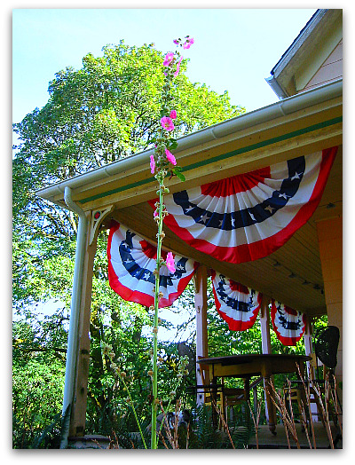 hollyhocks and bunting on the porch