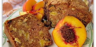 fresh peach cake sliced on a plate