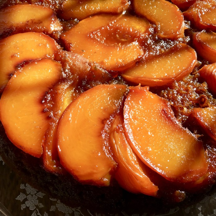 peach upside down cake now topped with peach