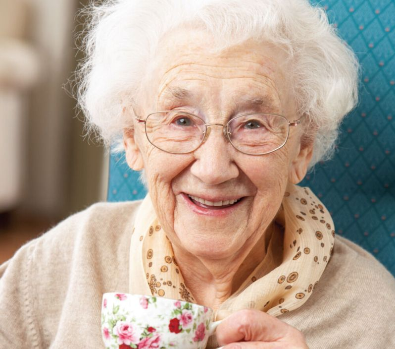 senior woman drinking a warm cup of tea