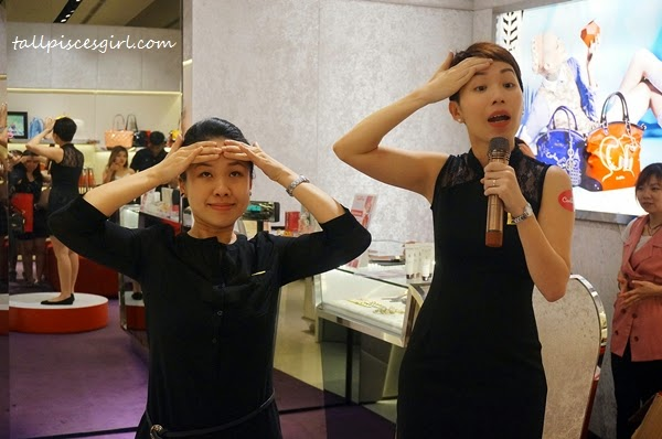 Sothys' staffs teaching us facial exercises