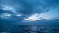 The cloud breaks at dusk