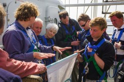 Hands on instructions for furling the fore course