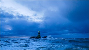 Dawn departure. Ijmuiden light house. Holland