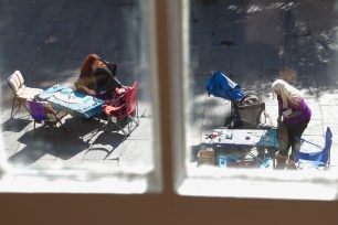 New Orleans has loads of people offering psychic readings, many just pop up a table like these ladies in Jackson Square as seen from upstairs in The Presbytere