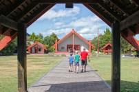 Walking onto the marae toward the Te Aronui a Rua meeting house