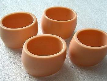 Vintage mid-century early plastic napkin rings - set of 4