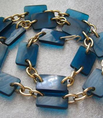 Vintage 1960 semi transparent blue early plastic and golden metal belt