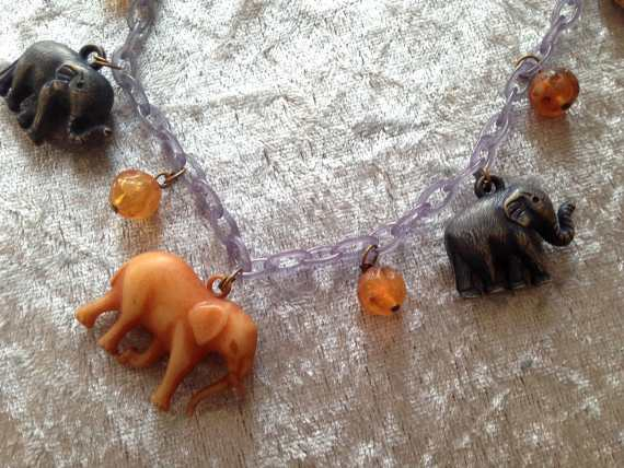 Vintage early plastic elephants necklace