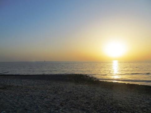 Sun setting over ANZAC Cove