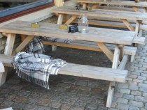 It is really common to see blankets with outdoor tables