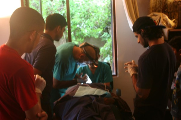Dentists working on a student