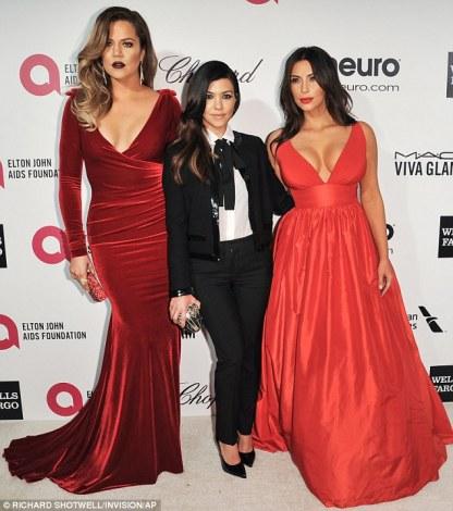 Khloe Kardashian wearing Marc Bouwer Kourtney Kardashian wearing Saint Laurent Kim Kardashian wearing Celia Kritharioti