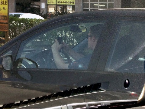This was taken along Commercial Boulevard of a driver texting while driving.  He was not at a stop light.