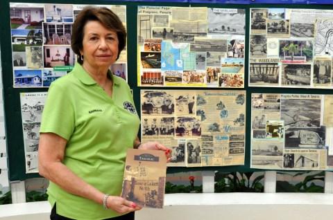 "Barbara Tarnove - President of the Tamarac Historical Society holds the new book ""Images of America - Tamarac"" at Tamarac City Hall"