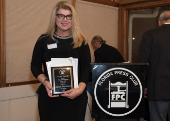 Sharon Aron Baron with award from the Florida Press Club