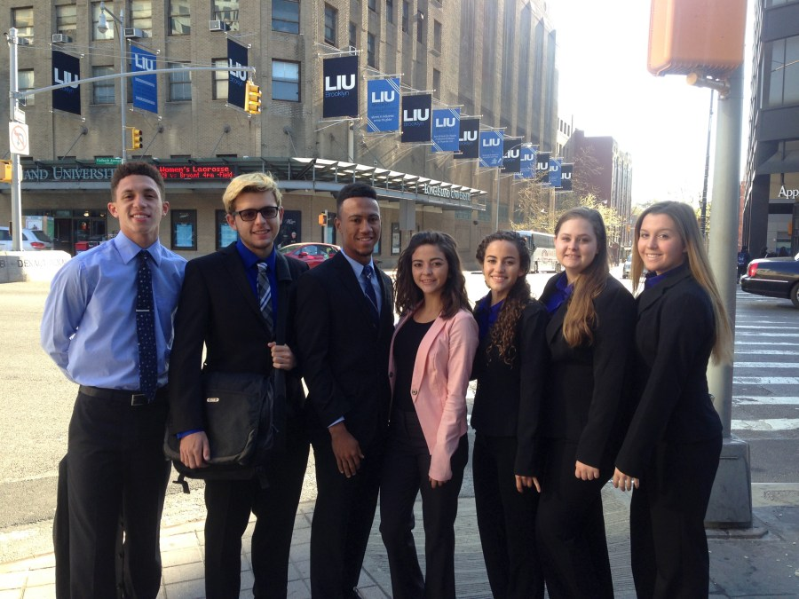 Left to Right:  JP Taravella seniors and Virtual Enterprise students Kaylon Schmidt, Michael Hazan, Aaron Mitchell, Josie Lang, Rachelle Serrano, Lauren Echols and Chloe Roque prepare to compete in the 2016 VE Business Plan Competition, hosted at Long Island University in Brooklyn, NY on April 17.