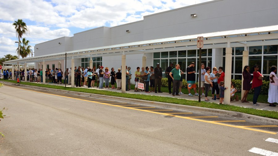 Voters didn't seem to mind waiting in the long lines for early voting at the Tamarac Branch Library on Monday.